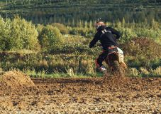 Motocross MX Rider riding on dirt track. Arnoldsweiler, Germany, October 05,2017:Extreme Motocross MX Rider riding on dirt track on a sunny late summer day on Royalty Free Stock Images