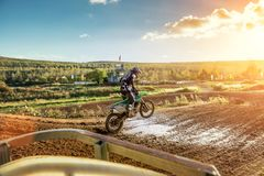 Motocross MX Rider riding on dirt track. Arnoldsweiler, Germany, October 05,2017:Extreme Motocross MX Rider riding on dirt track on a sunny late summer day on Royalty Free Stock Photos