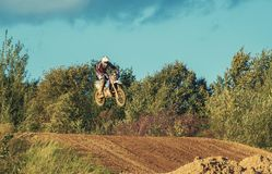 Motocross MX Rider riding on dirt track Stock Images