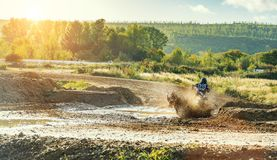 Motocross MX Rider riding on dirt track. Arnoldsweiler, Germany, October 05,2017:Extreme Motocross MX Rider riding on dirt track on a sunny late summer day on Royalty Free Stock Photo