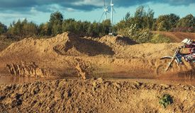 Motocross MX Rider riding on dirt track. Arnoldsweiler, Germany, October 05,2017:Extreme Motocross MX Rider riding on dirt track on a sunny late summer day on Stock Photography