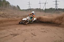 Motocross practice racer at turn of in sandy ruts Royalty Free Stock Photos