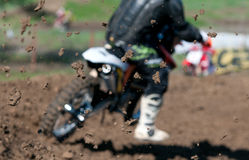 Motocross Race. Motorcyclist on motocross race  with focus on the clay Stock Photo