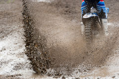 Motocross Race Mud Rider Splash. Motocross rider make huge mud splash royalty free stock images