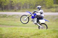Motocross Racer. A motocross biker popping a wheely Royalty Free Stock Photo