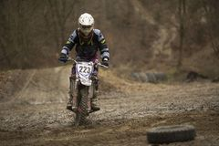 Motocross racer accelerating in dirt track. Motorcycle, Motocross, Motor Racing Dirt Road Cycling Stock Photo