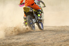 Motocross racer accelerating speed. In track Royalty Free Stock Images