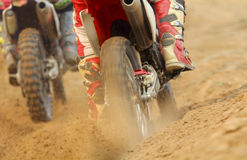 Motocross racer accelerating speed in track Royalty Free Stock Photography