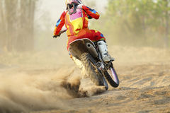 Motocross racer accelerating speed in track. Motocross racer accelerating speed in dirt track Stock Photo