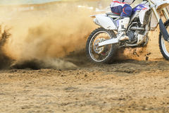 Motocross racer accelerating speed in track. Motocross racer accelerating speed in dirt track Royalty Free Stock Images