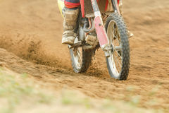 Motocross racer accelerating speed in track. Motocross racer accelerating speed in dirt track Royalty Free Stock Image