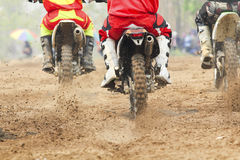 Motocross racer accelerating speed in track. Motocross racer accelerating speed in dirt track Stock Image