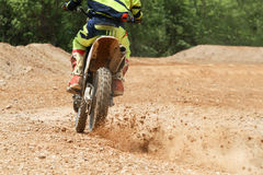 Motocross racer accelerating speed in track. Motocross racer accelerating speed in dirt track Royalty Free Stock Photography