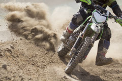 Motocross racer accelerating speed in track Stock Images