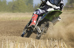 Motocross racer accelerating speed in track Royalty Free Stock Image