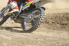 Motocross racer accelerating speed in track. Motocross racer accelerating speed in dirt track Royalty Free Stock Photos
