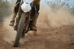 Motocross racer accelerating speed in track. Driving in the motocross race Royalty Free Stock Photos