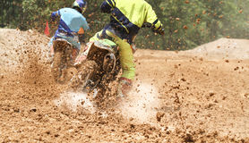 Motocross racer accelerating speed in track. Motocross racer accelerating speed in durt track Royalty Free Stock Image