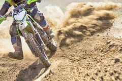 Motocross racer accelerating speed in track. Motocross racer accelerating speed in race track Stock Photography