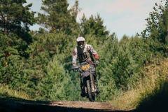 Motocross racer arrives on the mountain Stock Image