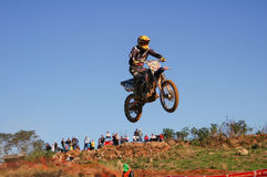 Motocross racer coming off a jump Royalty Free Stock Photo