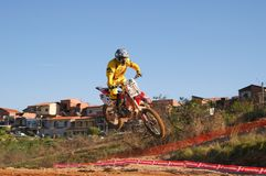 Motocross racer coming off a jump during state finals in Americana Royalty Free Stock Image