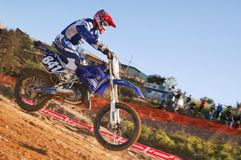 Motocross racer coming off a jump during state finals in Americana Stock Photography