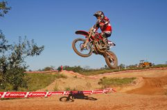 Motocross racer coming off a jump during state finals Royalty Free Stock Image