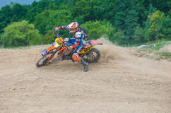 Motocross racer on corner Royalty Free Stock Photography