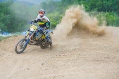 Motocross racer on corner Royalty Free Stock Image