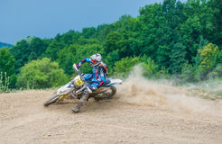 Motocross racer on corner Stock Photography