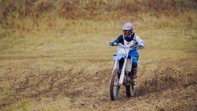 Motocross racer on dirt bike at sport track - fast and danger Stock Photo
