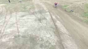 Motocross racer on enduro bike riding away rear view, motorcycles, rally, shooting from above. Hd stock video