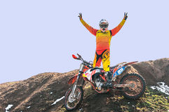 Motocross racer enjoy victory. Motocross racer with mud on motorbike enjoy victory Stock Photo