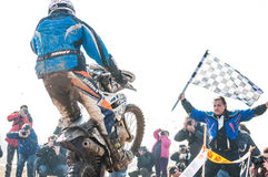 Motocross racer on finish. Motocross racer with mud on motorbike finish the race stock photo