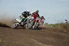 Motocross Racer First Corner After The Start Stock Image