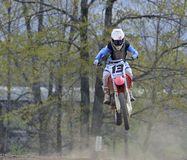 Motocross Racer Flying Through the Air Stock Image