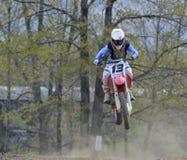 Motocross Racer Flying Through the Air Stock Image