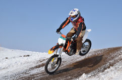 Motocross racer flying down the mountain Royalty Free Stock Images
