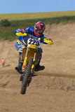 Motocross racer jumping with the bike Royalty Free Stock Image
