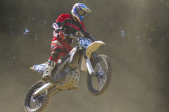 Motocross racer jumping with the bike Stock Photography