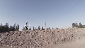 Motocross racer jumping on a motorcycle sequence stock video footage