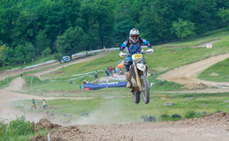 Motocross racer on jumping Royalty Free Stock Images