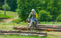 Motocross racer on log obstacles Royalty Free Stock Image