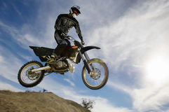 Motocross Racer In Midair Against Cloudy Sky Stock Photos