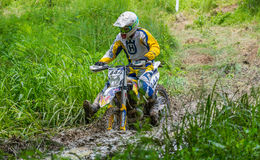Motocross racer on mud. Motocross racer on national championship stage. Event from 20.05.2015 in Moreni, Dambovita, Romania Royalty Free Stock Images