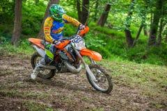 Motocross racer on mud Royalty Free Stock Photo