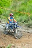 Motocross racer on mud Stock Photography