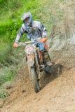 Motocross racer on mud Royalty Free Stock Image