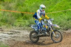 Motocross racer on mud Royalty Free Stock Image